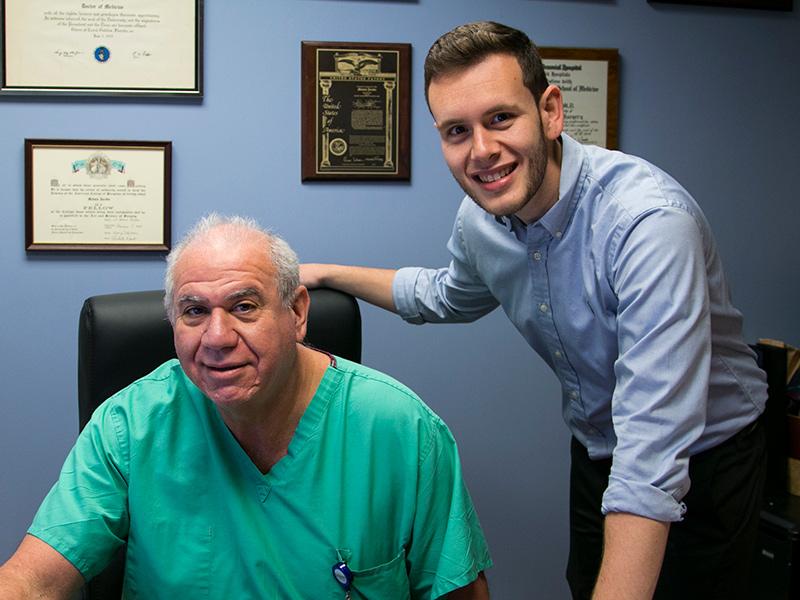 Robert Toledo standing next to his bariatrics surgeon