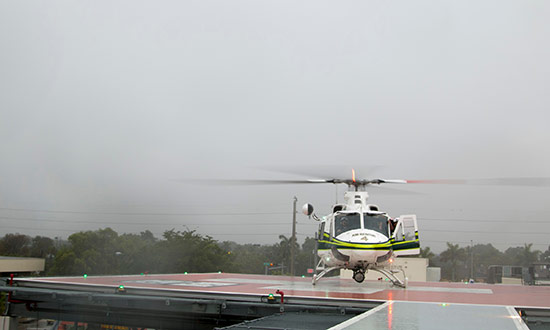 A helicopter landing on a helipad at Jackson