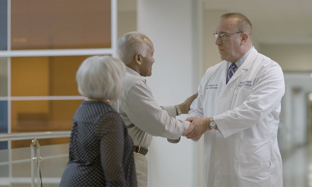Dr. Segurola greeting a patient and his wife