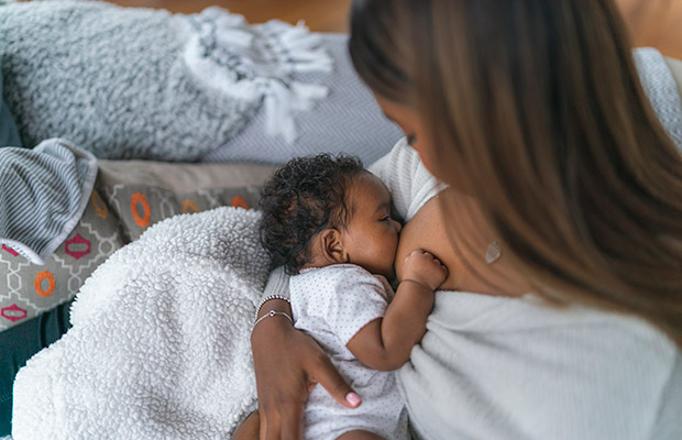 Closeup of a woman breastfeeding her baby