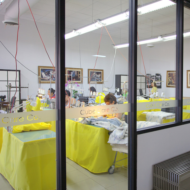 A view of numerous people working on sewing machines