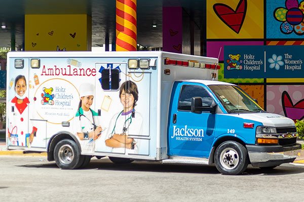 An ambulance for Holtz Children's Hospital outside of a Pediatric Emergency Room