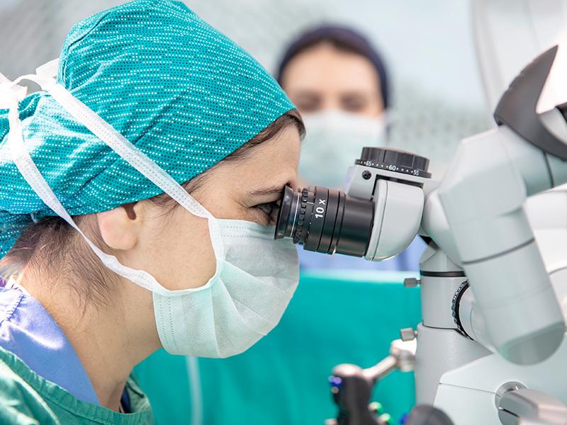 Closeup of a surgeon looking into a surgery robot