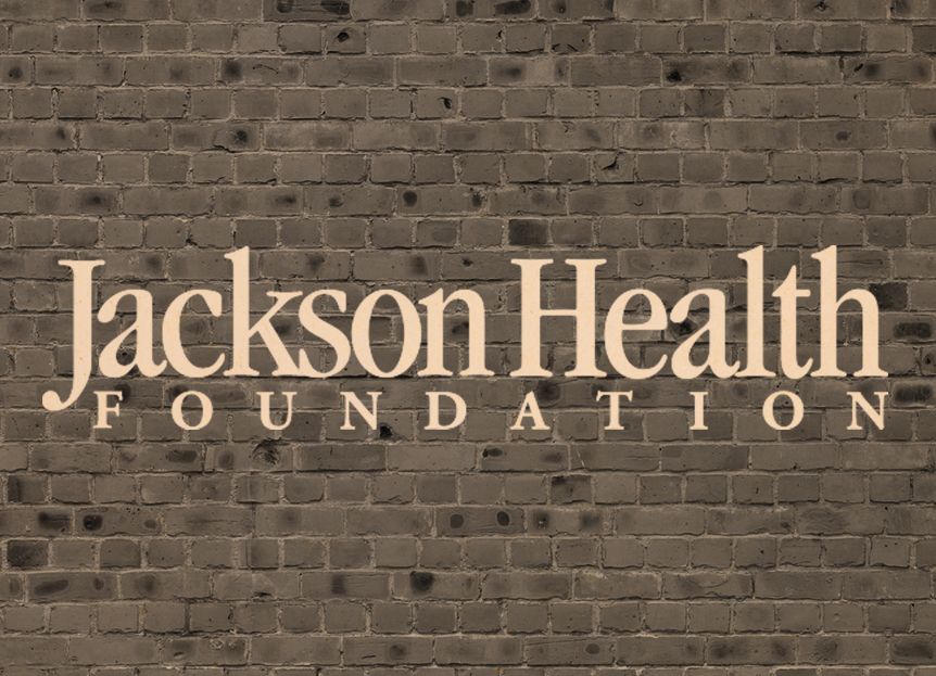 Jackson Health Foundation logo over a brick wall