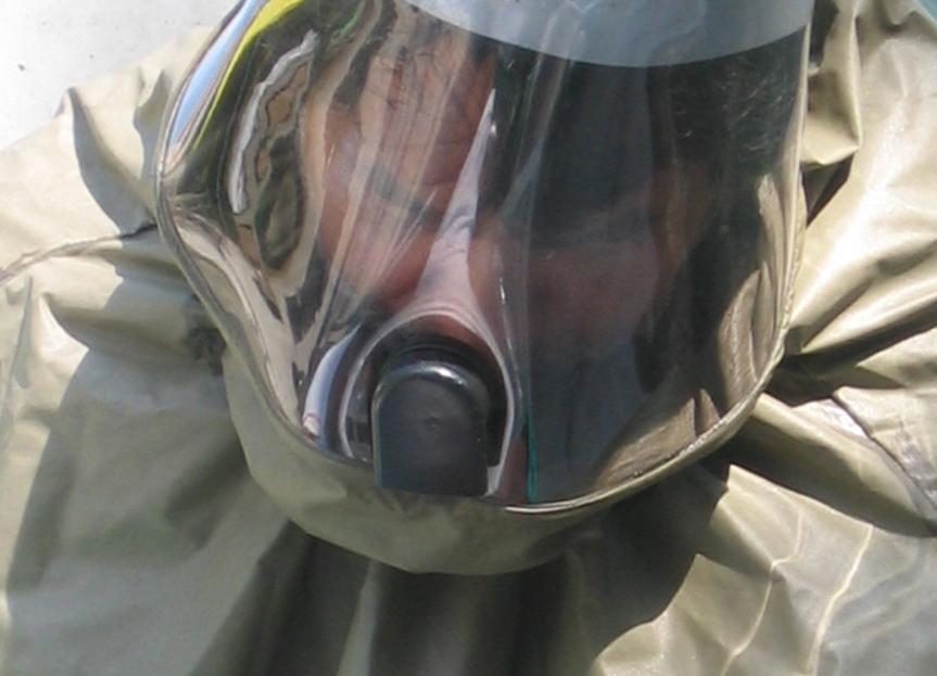 A closeup of a person wearing a hazmat suit