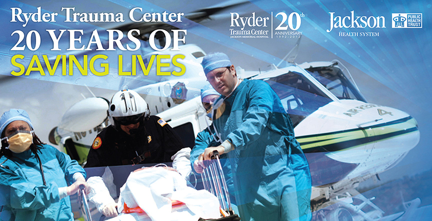 Physicians bringing in a patient from a helicopter, Ryder Trauma Center 20 years of Saving Lives is written over the image