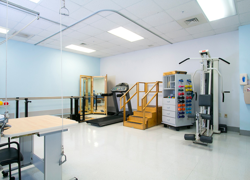 A rehabilitation room filled with tools and machines to help a person rehabilitate