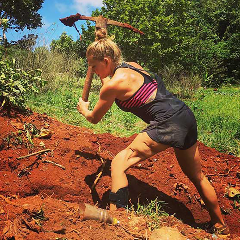 Danielle Press working on a farm, she is digging dirt