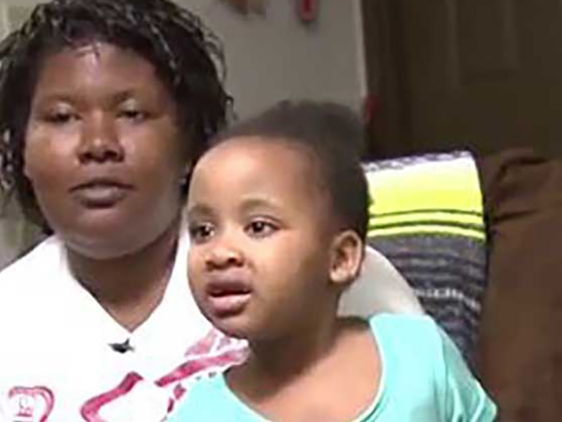Tiffany Davis sitting down with her young daughter, Skyla Milton