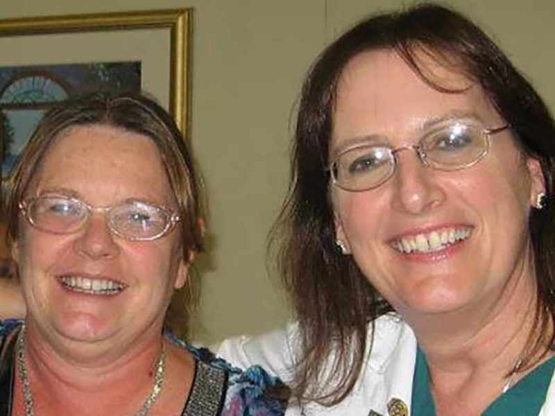 Closeup of Desiree Meyer smiling next to her physician