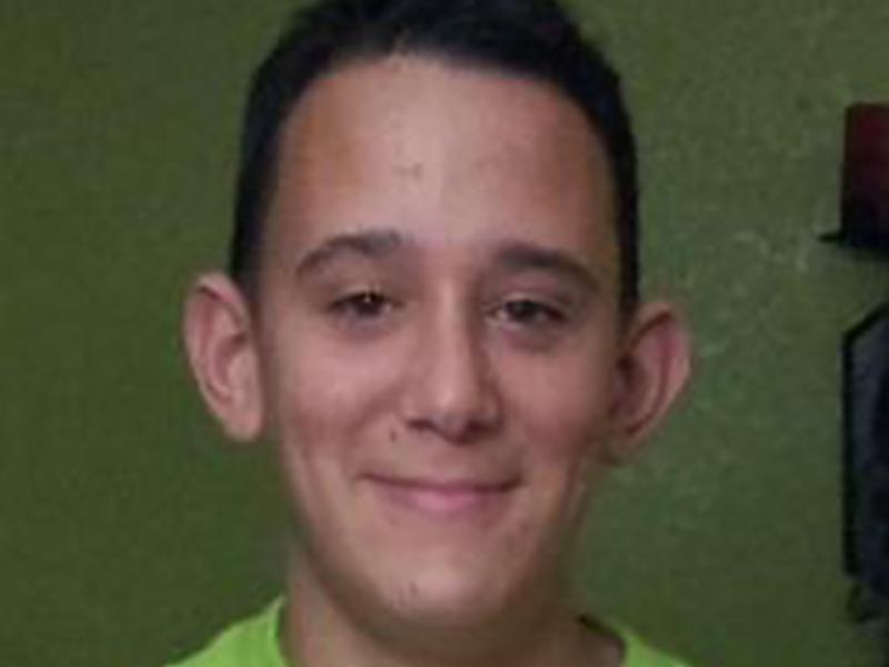 A closeup of Yasser Lopez smiling