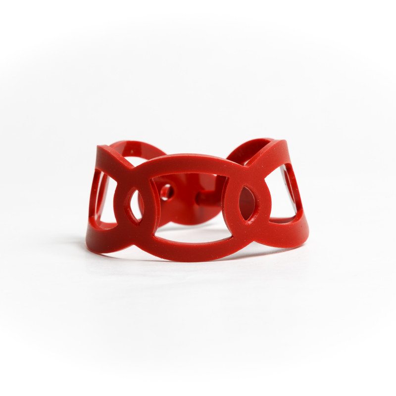 Geometric cuff bracelet made of flexible resin. Available in blue and black.