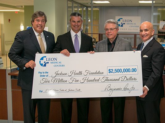 Four men holding a check for two million five hundred thousand dollars from Leon Medical Center to Jackson Health Foundation