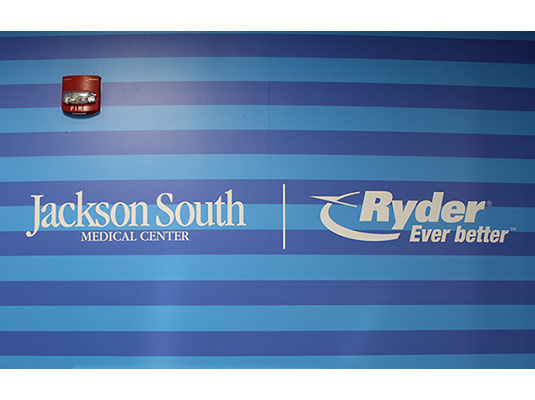 Jackson South Medical Center and Ryder logos on a wall