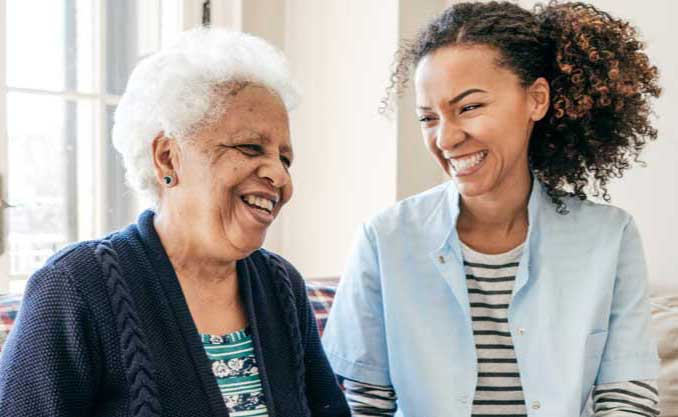 A woman visits her elderly mother