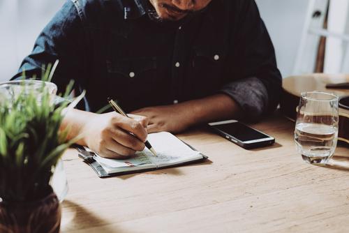 man-writing-checklist