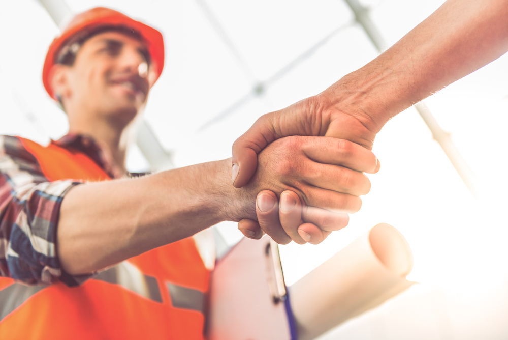 construction-workers-shaking-hands
