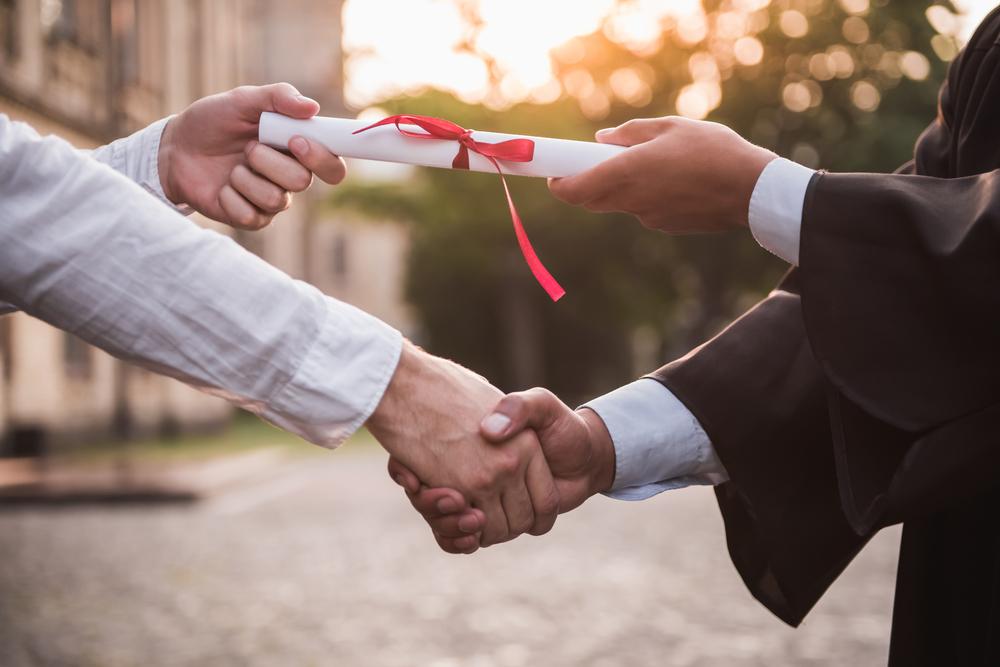 graduation-handshake-with-diploma