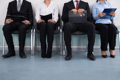 employees-sitting-in-line