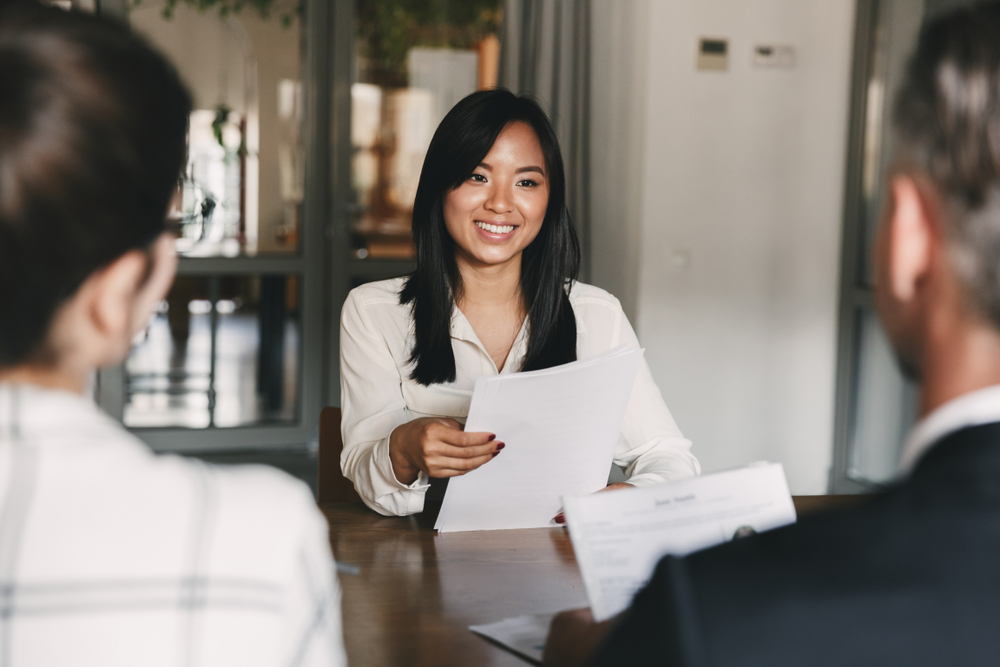 A woman holding her resume