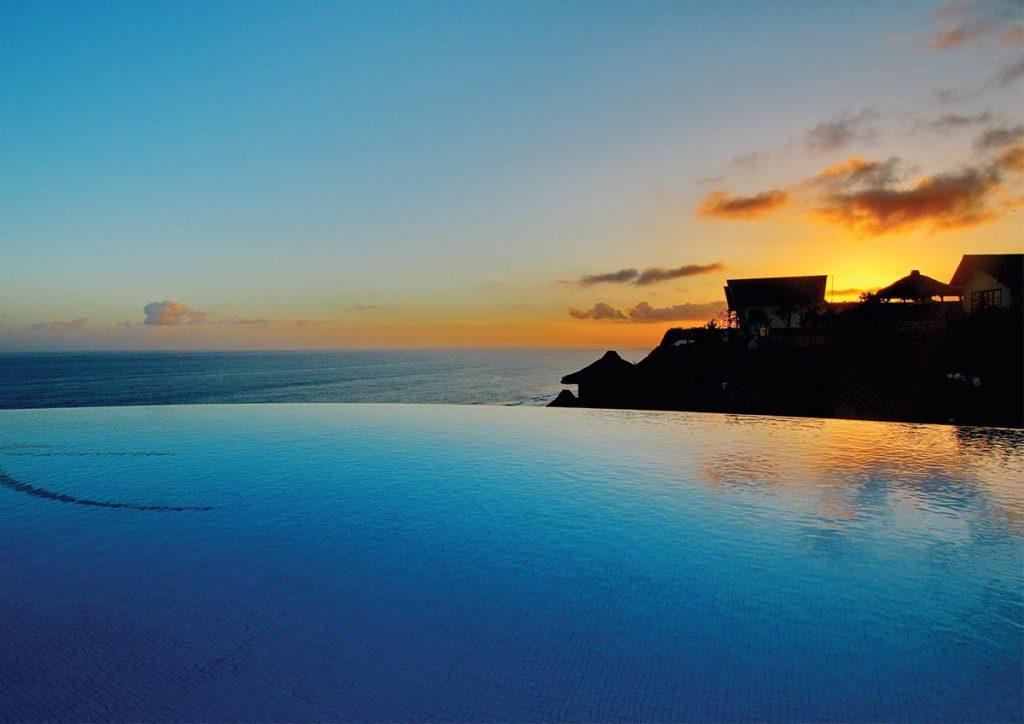 Infinity pool of luxury resorts karma kandara in sunset