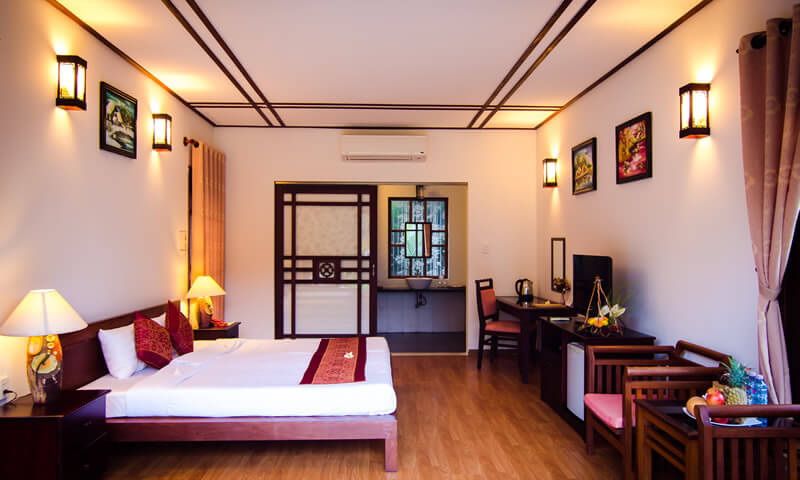 elegant and classic interior Deluxe bedroom of luxury resort karma cay tre