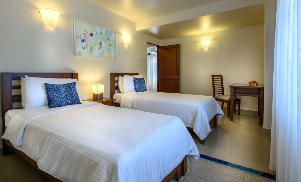 double bed at luxury hotel Karma Royal Monterio