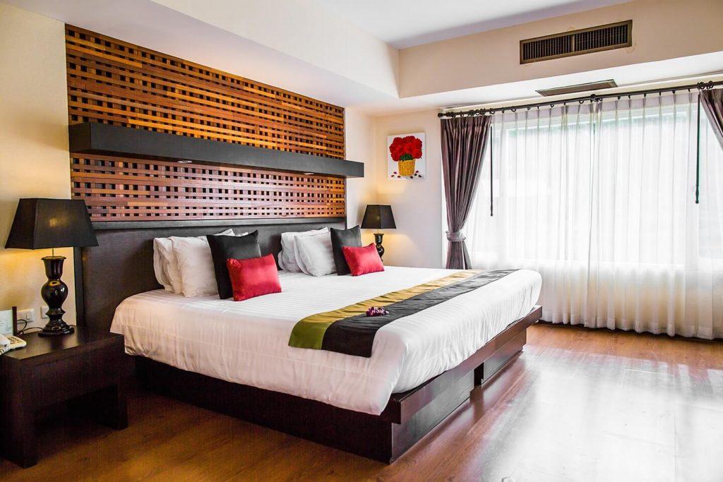 dark brown dominant interior of luxury hotel Karma Royal Bella Vista Bedroom