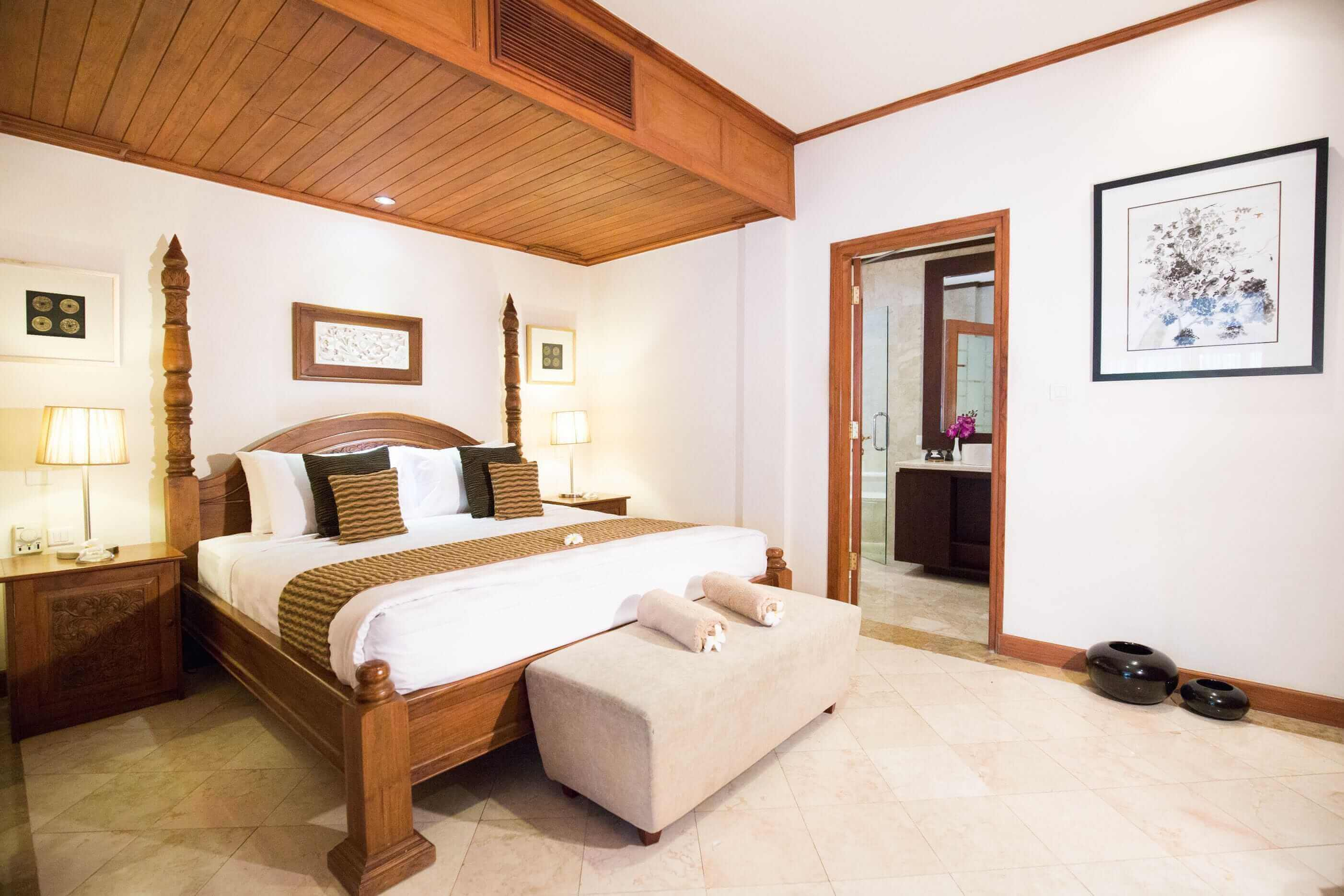 white and wood interior bedroom of luxury hotel Karma Royal Jimbaran Accommodation
