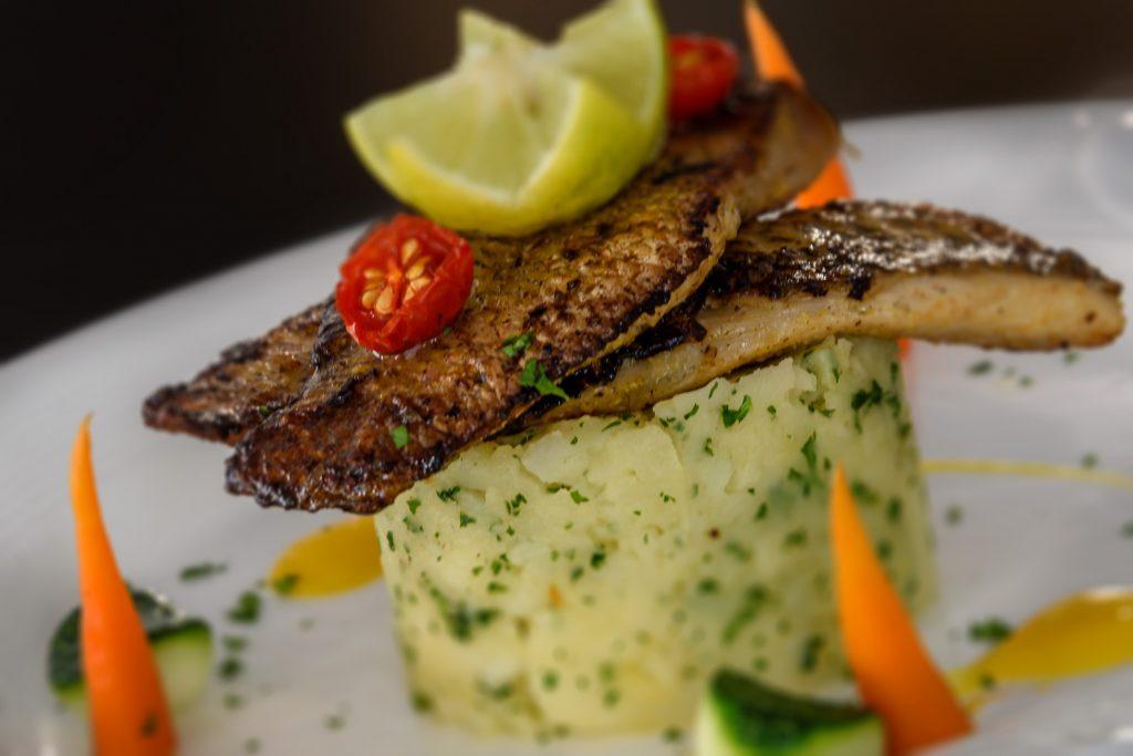 seasoning rice with grilled fresh fish of luxury hotel Karma Royal Benaulim Cuisine