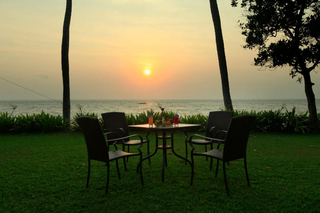 outdoor seating with romantic moment of Karma Chakra Sunset