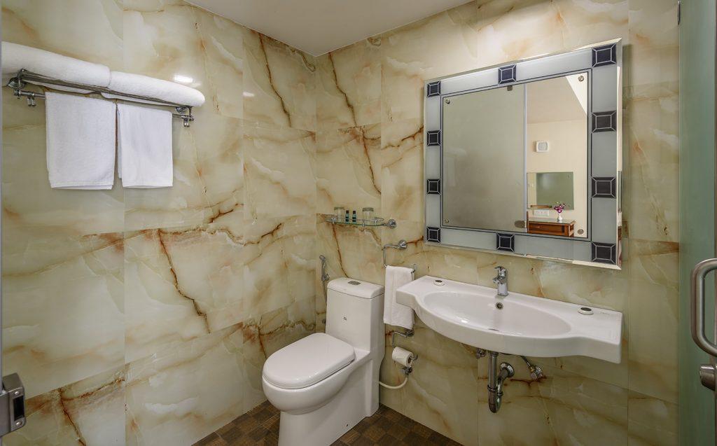 clean bathroom of luxury hotel Karma Royal Benaulim Accommodation
