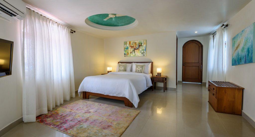 romantic white bedroom of luxury hotel Karma Royal Monterio
