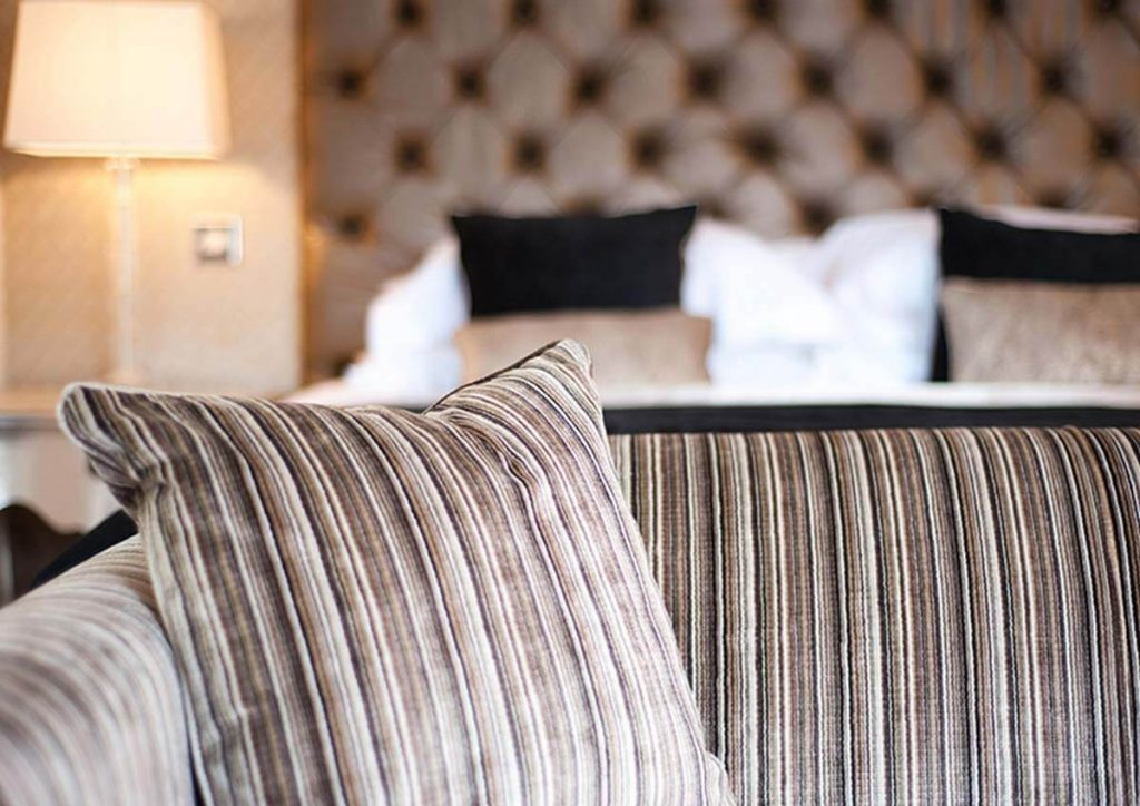 brown stripped sofa pillow of luxury hotel karma sanctum on the green