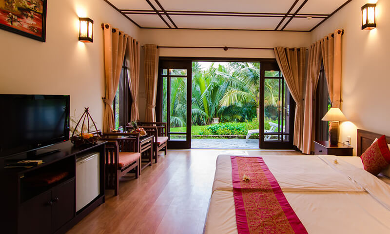 luxury resort bedroom with garden view at karma cay tre