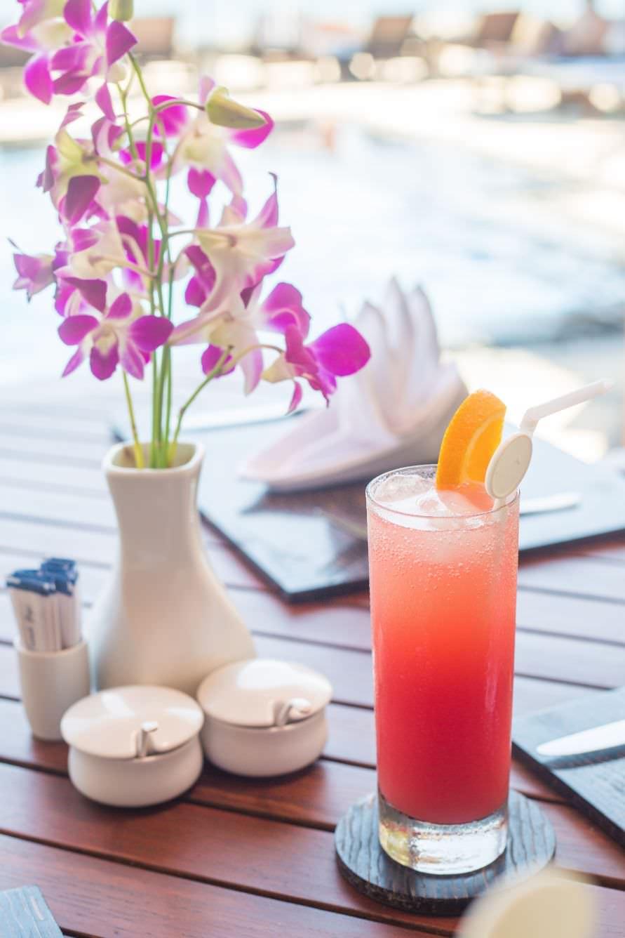 red orange and fresh Karma Royal Candidasa Cocktail