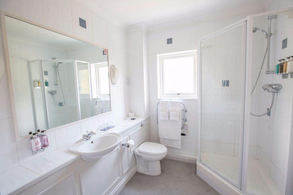 White and elegant bathroom at Karma St. Martin's