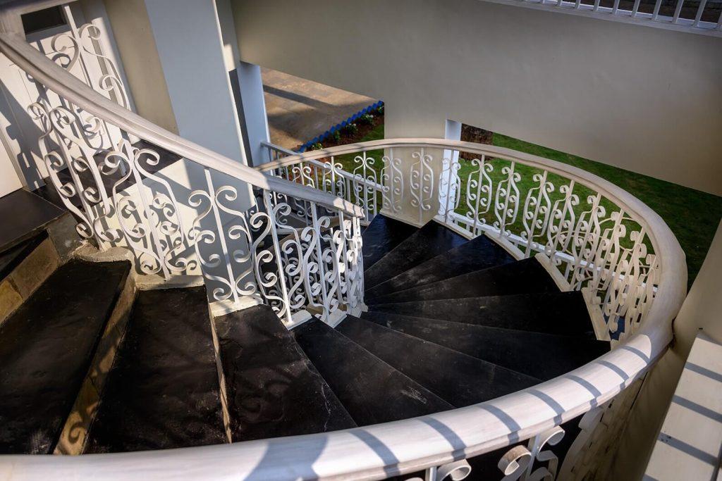 elegant spiral white stairs of luxury hotel Karma Royal Benaulim