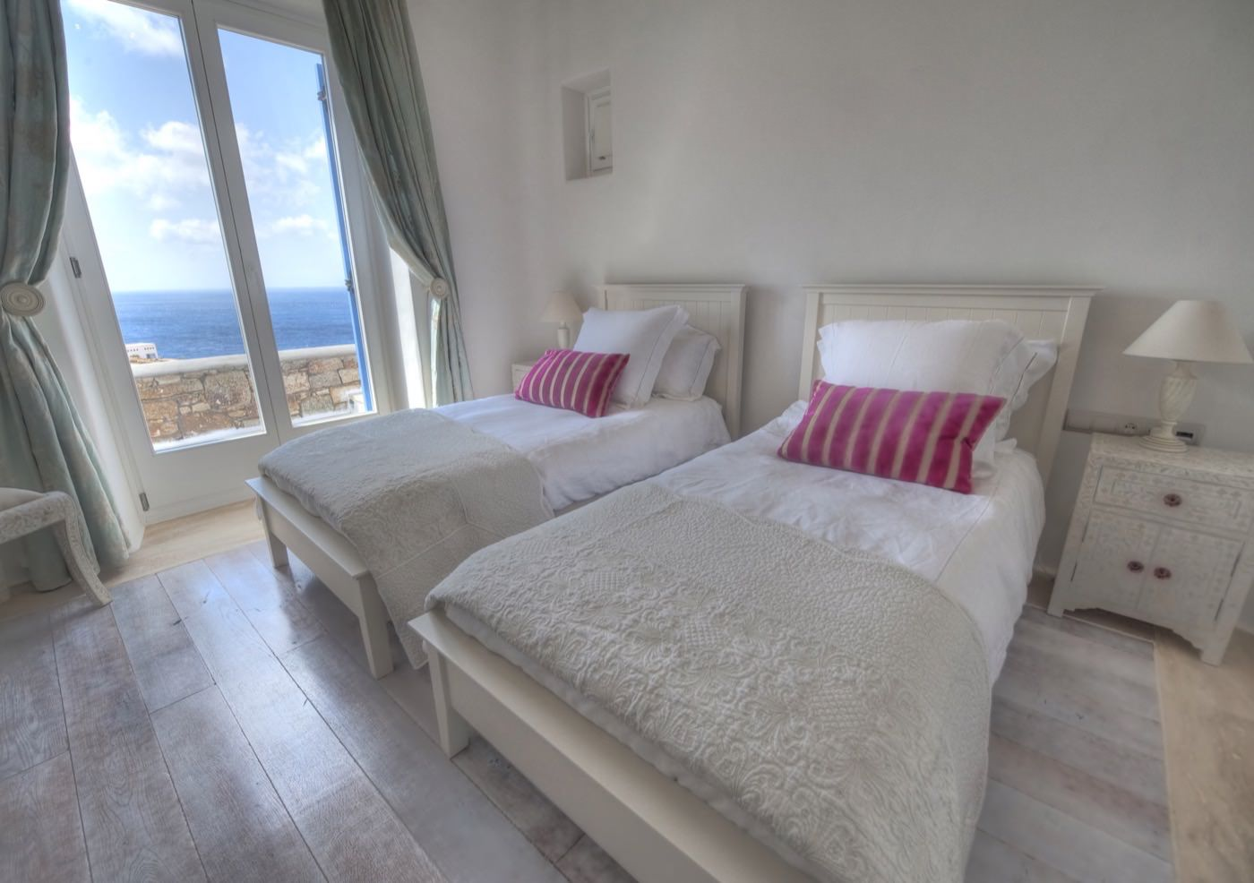 Luxury hotel of Karma Pelikanos Accommodation white and fluffy bedroom