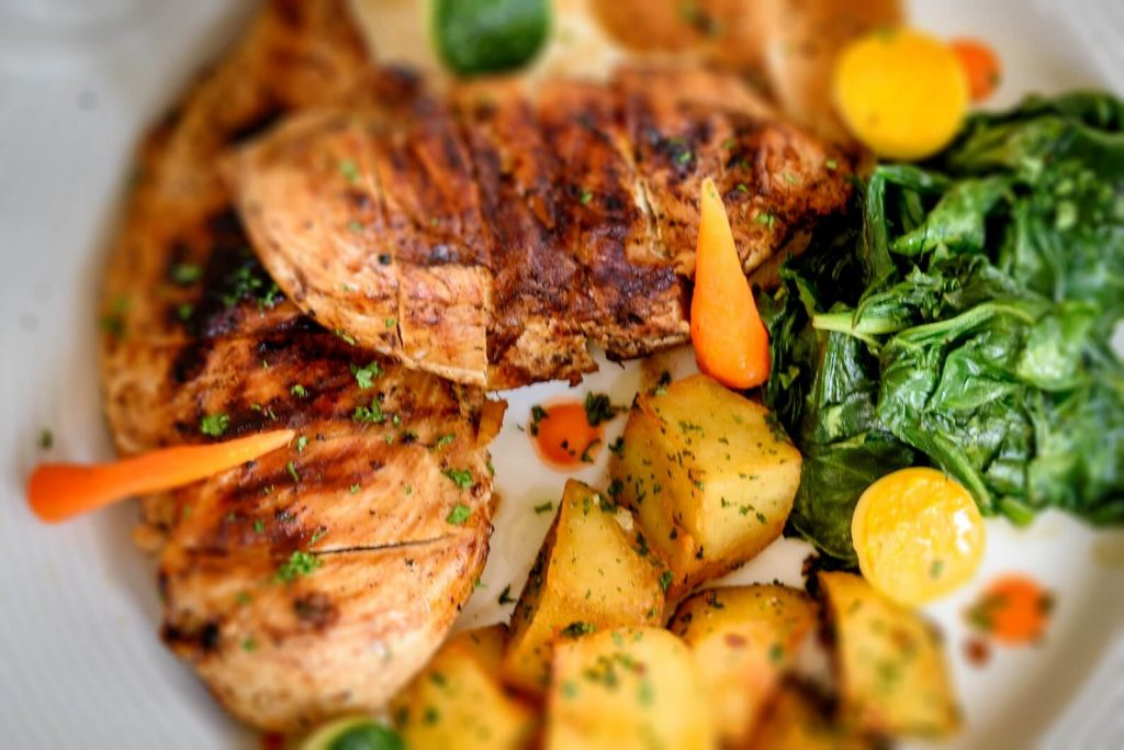 fresh grilled fish and potatoes of luxury hotel Karma Royal Benaulim Cuisine