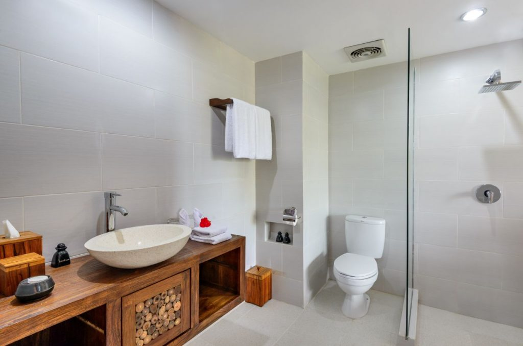 white and wood interior of luxury hotel Karma Mayura Deluxe Accommodation Bathroom
