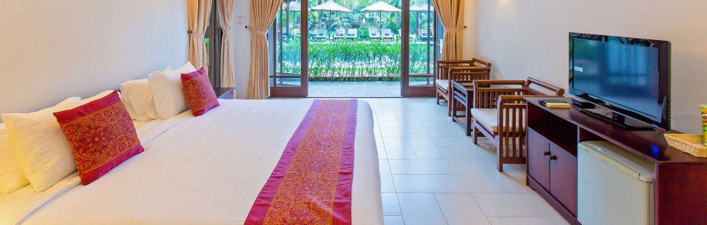 elegant and beautiful bedroom of luxury hotel karma cay tre