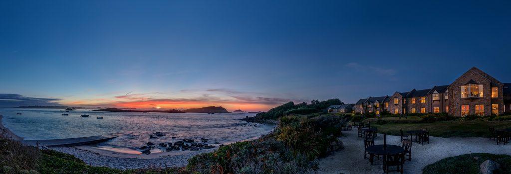beautiful seaside sunset seating restaurant of luxury hotel Karma Saint Martin's