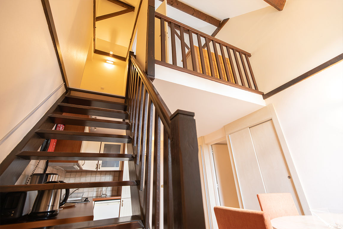 luxury residence of Karma Residence Normande wood stairs