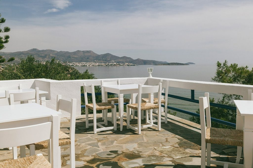 roof top restaurant with ocean view of luxury hotel karma minoan