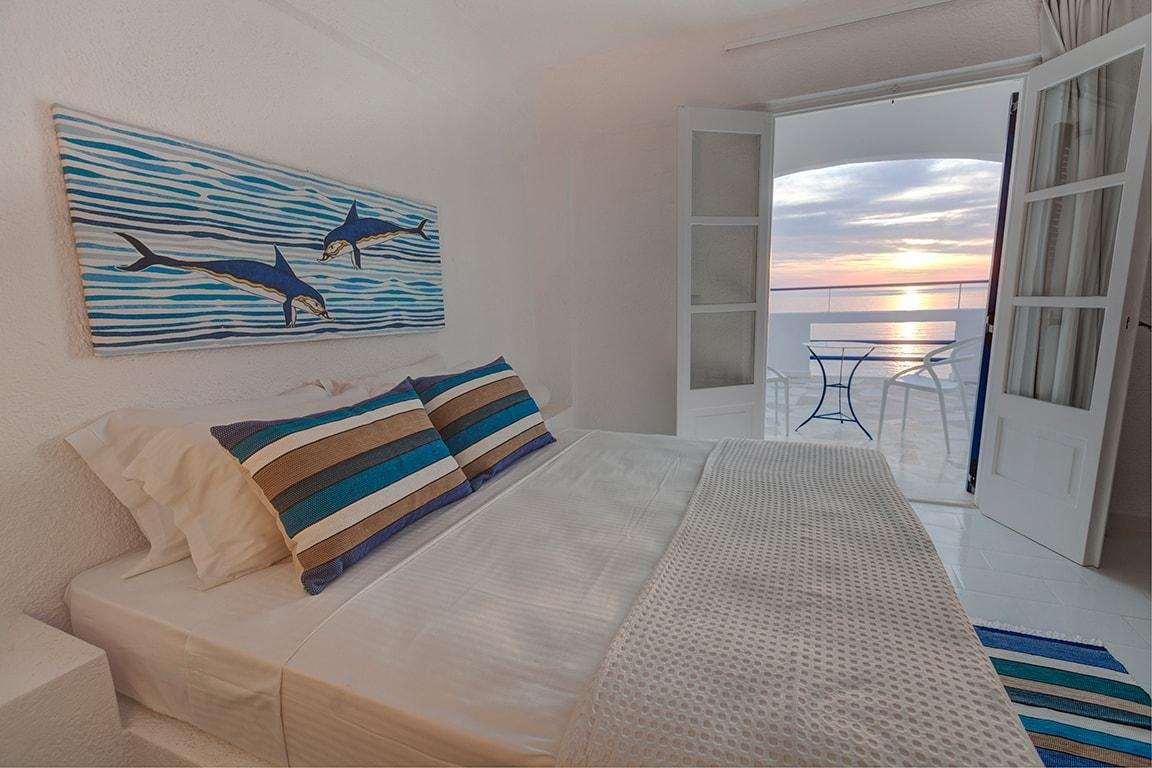 peach beauty interior with ocean sunset view of luxury hotel karma minoan