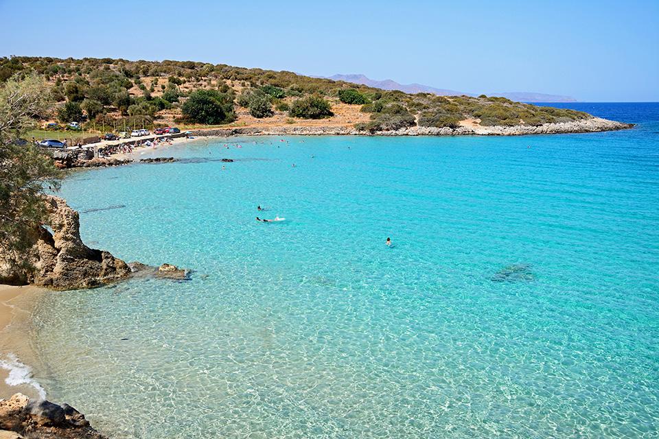 peaceful blue beach at luxury resort karma minoan beach