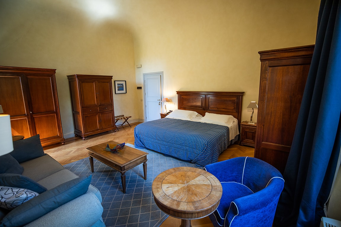 luxury resort of Karma Borgo Di Colleoli bedroom with blue cover
