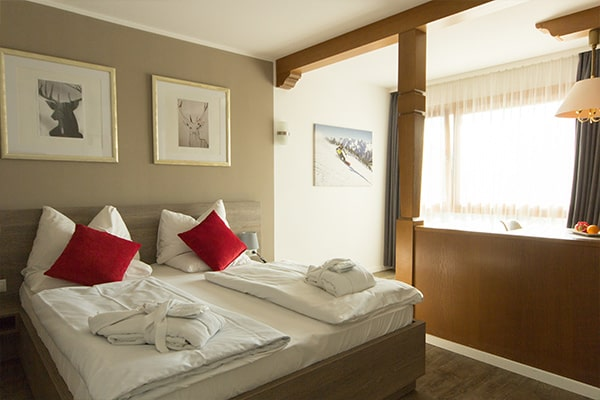 Karma Bavaria Resort Page DE Karma Sixtus One Bedroom Suite