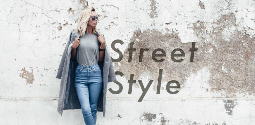 Street style danois, femme en jean avec manteau en laine et un sweatshirt gris.